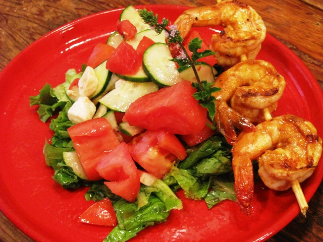 Salad plated with Shrimp Skewers
